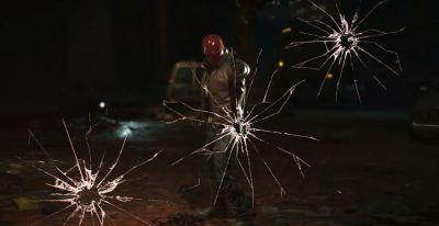 The Red Hood shows off all his toys in his reveal trailer