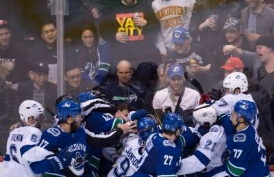 Lightning strike down Canucks in heated battle