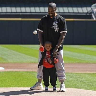 This Photo Of Kanye West & Saint At The Chicago White Sox Game Is A Cute Father-Son Moment