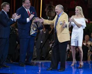 The Latest: Lombardi Era guard Kramer inducted into hall