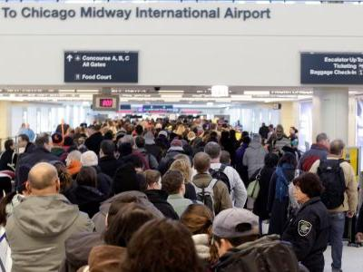 500 flights have been canceled as a winter storm pummels the Midwest on the busiest travel day of the year