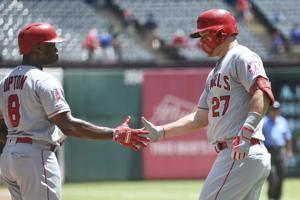 Rookies push Rangers to 3-1 win for split of DH with Angels