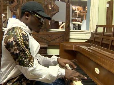 College student given valuable piano after playing for patrons at Mass. shop
