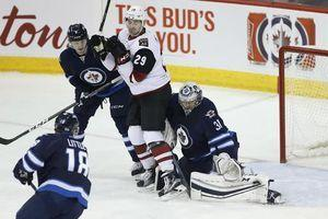 Pavelec lifts Jets past Coyotes 6-3 in season debut