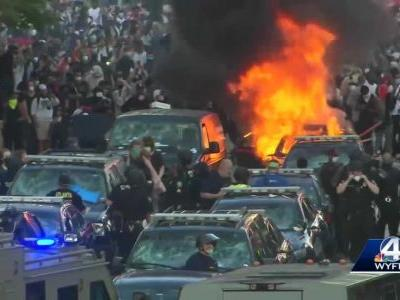 Protest in Columbia turns violent; rocks thrown, police cars set on fire
