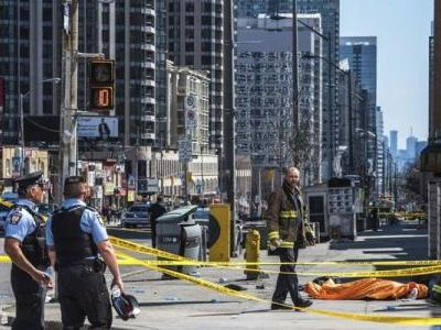 Van jumps sidewalk, injuring at least 7 pedestrians in Toronto; police say driver is in custody