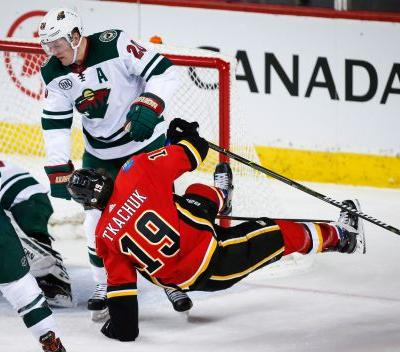 Smith has 31 saves, Lindholm scores 2 as Flames top Wild 2-0