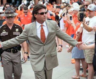 Oklahoma State football coach Mike Gundy's contract reduced by $1 million, one year after internal investigation