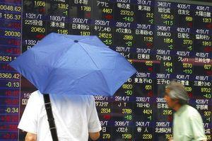 World shares mostly higher as markets await Fed's decision