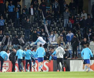 Marseille's Evra sent off before game for lashing at fan