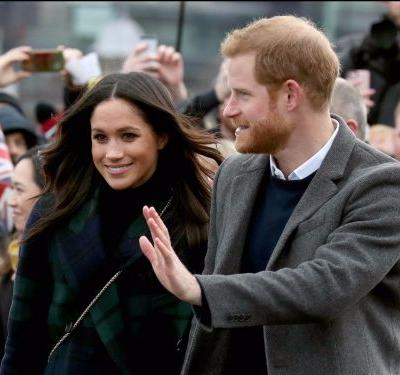 Watch Meghan Markle burst out laughing after an adorable pony bites Prince Harry's hand