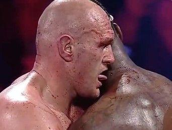 Tyson Fury appears to lick blood off Deontay Wilder's neck