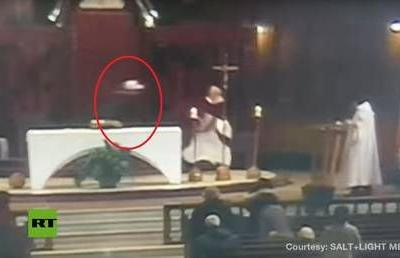 Moment of stabbing attack on Canadian priest during mass caught on camera