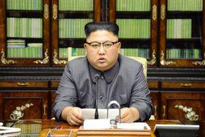 Kim fires off insults at Trump and hints at weapons test