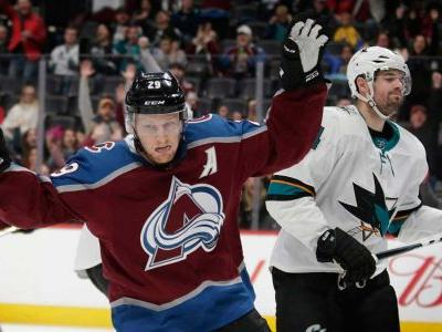 MacKinnon, Avs win 8th straight by holding off Sharks