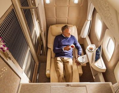 The first class cabin war: Emirates unveils 'zero gravity' flat beds inspired by Nasa
