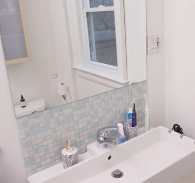 How To Transform A Tiny, Boring Bathroom Into A Stylish, Organized Retreat For Under $250