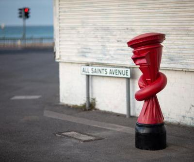 The U.K.'s Iconic Red Post Box Gets a Twisted Makeover in Alex Chinneck's Surreal Urban Interventions