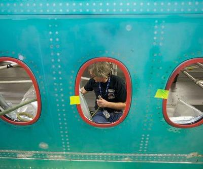 Boeing announces voluntary layoffs to cut costs as coronavirus leaves it in 'uncharted waters'