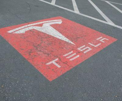 New rules on making cars in China could help Tesla - or give it even more to worry about
