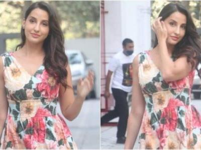 Nora Fatehi in floral midi dress and Rs 1 lakh bag celebrates 1 billion views for Dilbar