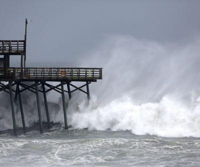 Hurricane Florence could bring a wall of water up to 11 feet high -here's what a storm surge is and why it forms