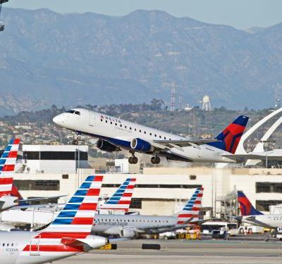 American Airlines and Delta Air Lines have been fined $1.75 million for keeping passengers stuck on delayed flights for hours