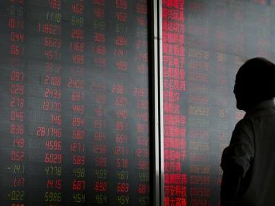 Asian stocks fall, oil gives up some gains after China move