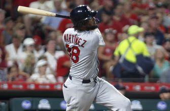 Reds' late rally falls short in wild 12-11 loss to Cardinals