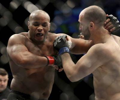 The Latest: Miocic keeps UFC heavyweight title with decision