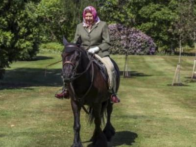 Queen Elizabeth rides a pony in Windsor Home Park as British lockdown eases