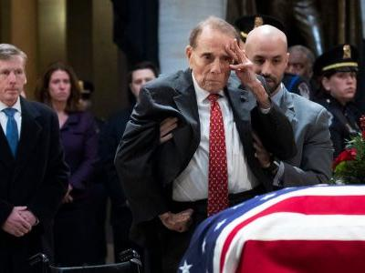At 95, Bob Dole stands up from wheelchair to salute fellow WWII hero George HW Bush