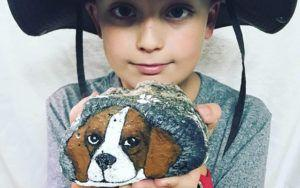 "Boy Sells Rocks To Care For Adopted Beagle With ""Broken Heart"""