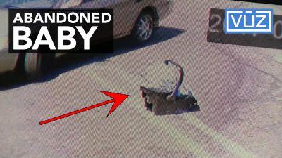Man caught on surveillance video abandoning baby in parking lot