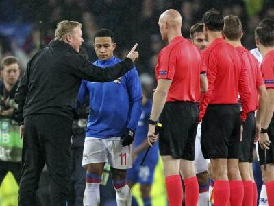 Lyon player punched by supporter holding child at Everton