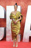 Um, Rihanna's Gold Dress Is SO Daring, It's Barely Staying in Place