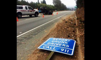 Drunk driver crashes into 'Report Drunk Drivers' sign on highway