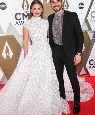 Wedding Bells? Hannah Brown Stuns in White Gown With Alan Bersten on CMAs Red Carpet
