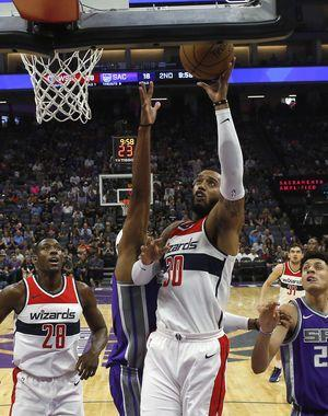 Wall, Wizards lead early and roll past Kings 110-83