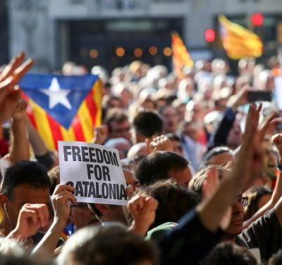 Spain has arrested 12 officials, seized 45,000 letters, and confiscated 1.3 million posters and flyers in a bid to stop Catalonia's independence vote