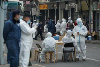A year after Wuhan lockdown, China sees small rise in COVID-19 cases