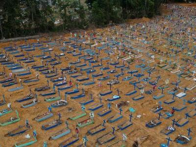 Photos of mass graves in Brazil show the stark toll of the coronavirus, as experts predict that it will surpass 125,000 deaths by August