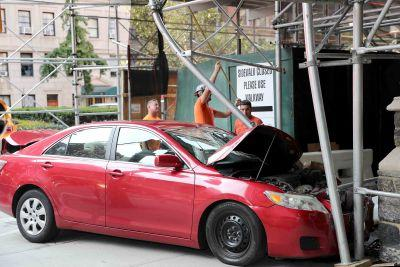 Taxi crashes into car, which then rams construction worker