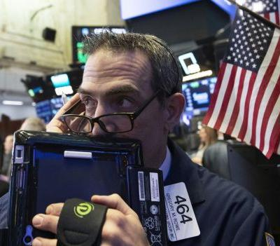 Stocks end mixed and oil rallies