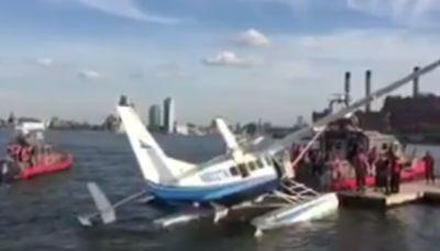 Seaplane makes emergency landing in New York's East River ; 7 rescued, none injured