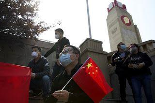 China honors virus victims with 3 minutes of reflection