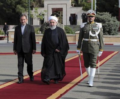 Iran's president blames unnamed US ally for military parade attack