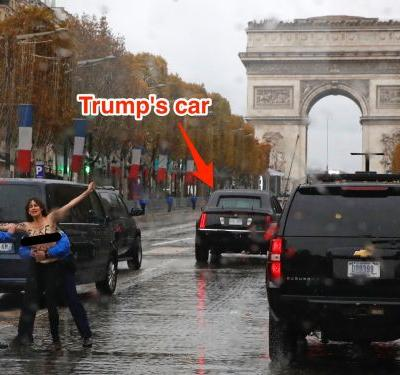 A topless protester got dangerously close to Donald Trump's motorcade in Paris