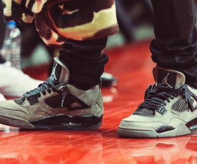 "Travis Scott Sports the Air Jordan 4 ""Dark Grey"" to Game 1 of the NBA Western Conference Finals"
