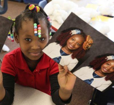 Akron teacher hopes to make school photos accessible to all students